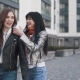Girls Young Female Friends Giving Piggyback on Vacation Laughing and Walking on City Promenade in - VideoHive Item for Sale