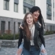 Girls Young Female Friends Giving Piggyback on Vacation Laughing and Walking on City Promenade - VideoHive Item for Sale