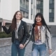 Cheerful Girls Walk Around the Spring City, Laugh, Smile and Hug - VideoHive Item for Sale