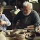 Child Is Learning To Work with Clay and Having Fun Kneading It While Staying with His Grandfather in - VideoHive Item for Sale