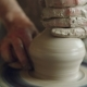 Shot of Half-finished Ceramic Jar Spinning on Potters's Wheel and Hands Molding Clay with - VideoHive Item for Sale