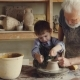 Curious Boy Is Learning Pottery From His Experienced Grandfather in Small Home Studio. Child Is - VideoHive Item for Sale