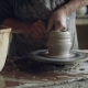 Tilt-up Shot of Professional Potter Creating Jar From Brown Clay in Workplace Using Throwing-wheel - VideoHive Item for Sale