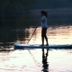 Beautiful Girl Floats Standing on Sup and Rows by Oars at Sunset - VideoHive Item for Sale