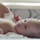 Female Hands Undress Newborn Baby Boy - VideoHive Item for Sale
