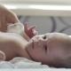 Female Hands Undress Newborn Baby Boy - VideoHive Item for Sale