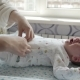 Adorable Newborn Baby Crying While His Mother Dressing Him - VideoHive Item for Sale
