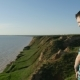 Impressed Boy Looks at Calm Black Sea Waters in Summer - VideoHive Item for Sale
