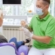Dentist Showing Plastic Model of Teeth to His Patient - VideoHive Item for Sale