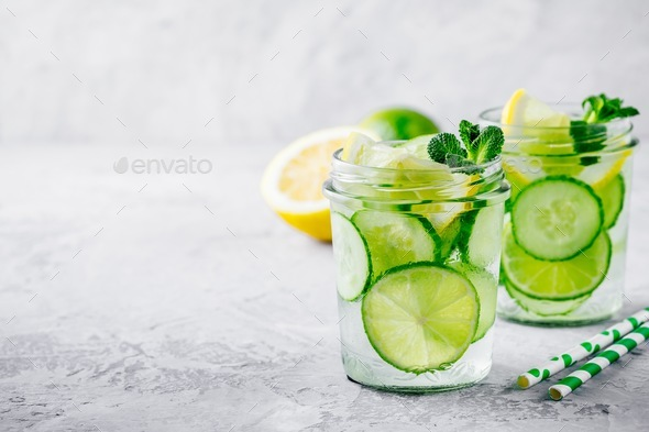 Infused detox water with cucumber, lemon and lime. - Stock Photo - Images