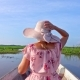 Female Tourist in Hat Riding Boat. Young Woman Visiting Thale Noi Waterfowl Reserve Lake, Thailand - VideoHive Item for Sale