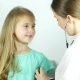 Friendly Pediatrician Doctor Examines a Girl with Stethoscope Checking Lungs - VideoHive Item for Sale