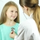 Cute Smiling Little Girl in Hospital. Doctor with Stethoscope Examining Young Girl - VideoHive Item for Sale