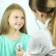 Pediatrician Talks To Smiling Girl and Listenes Heart Beat Using a Stethoscope - VideoHive Item for Sale