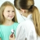 A Female Doctor Hearing Heartbeat of Cute Young Girl. Review of a Child in a Pediatrician - VideoHive Item for Sale