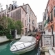 ITALY, VENICE - FEBRUARY 15: Tourists Traffic and Boat on Small Canal in Venice - VideoHive Item for Sale