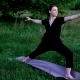 Young Woman Practising Yoga Outdoors on the Grass - VideoHive Item for Sale