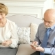 Portrait of Happy Attractive Elderly Couple Watching Old Photos - VideoHive Item for Sale