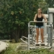 Woman Doing Exercise at the Outdoor Gym on the Beach - VideoHive Item for Sale