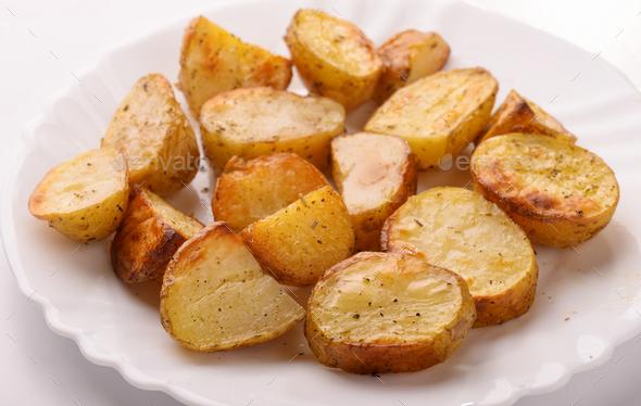 Close up of  baked potato wedges - Stock Photo - Images