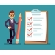 Businessman Holding Pencil at Complete Checklist