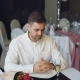 Loving Man Is Waiting for His Girlfriend in Restaurant, She Is Coming Closing His Eyes with Her - VideoHive Item for Sale