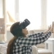 Young Woman with Virtual Reality Headset or 3d Glasses Sitting on Sofa at Home - VideoHive Item for Sale