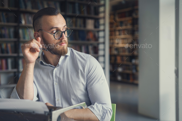 Young man in the library - Stock Photo - Images