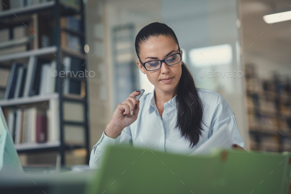 Young businesswoman at work Stock Photo by AboutImages   PhotoDune