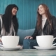 Coffee Mugs . Girls Take Mugs and Drink at the Same Time - VideoHive Item for Sale
