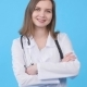 Smiling Female Doctor in White Coat with Stethoscope - VideoHive Item for Sale