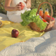 The Woman Takes out Fruit and Drinks from the Basket - VideoHive Item for Sale