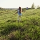 Cheerful Little Girl Running Away on Hill - VideoHive Item for Sale