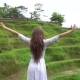 Travel Concept. Woman in Long Dress Walking Near Rice Terrace and Raise Hands - VideoHive Item for Sale