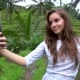 Woman Making Self-portrait Picture with Smartphone on Rice Terrace Background - VideoHive Item for Sale