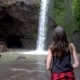 Hiker Woman Looking at Waterfall in Forest - VideoHive Item for Sale