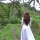 Woman in Long Dress Walking near Rice Terrace and Raising Hands - VideoHive Item for Sale
