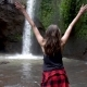 Female with Arms Wide Open Near the Waterfall in Bali - VideoHive Item for Sale