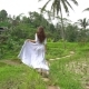 Travelling in Bali. Woman in Long Dress Running on Rice Terrace Track. - VideoHive Item for Sale