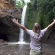 Man Raising Arms Victoriously Reaching Waterfall - VideoHive Item for Sale