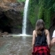 Hikers Man and Woman Exploring Waterfall in Forest. Couple Trekking in Bali - VideoHive Item for Sale
