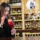 A Girl Drinks a Red Cocktail at the Bar in the Bar, Woman Drinking Red Exotic Cocktail - VideoHive Item for Sale