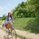 Attractive Girl in a Hat on a Bicycle Traveling in Nature - VideoHive Item for Sale