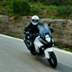 Motorcyclist Driving his Sports Motorbike on a Curvy Road - VideoHive Item for Sale