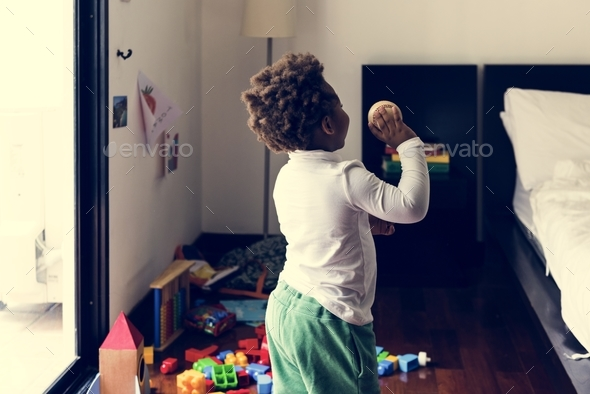 Black kid throwing baseball ball - Stock Photo - Images