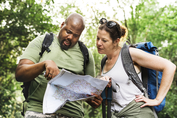 Checking on the map for directions - Stock Photo - Images