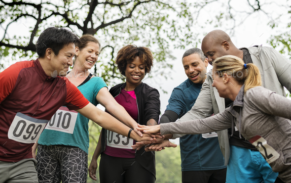 Team of diverse people ready for a race - Stock Photo - Images