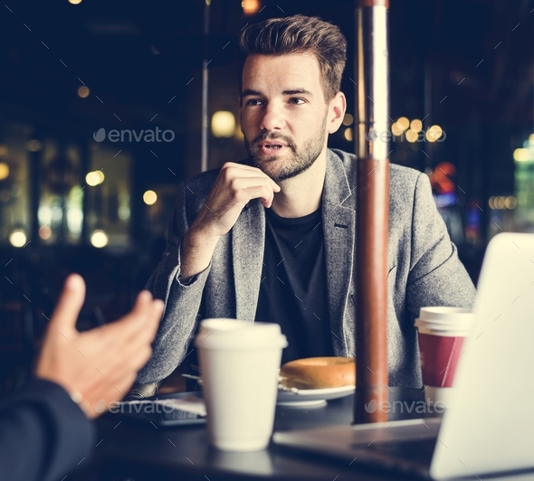 Business partners working together at a cafe - Stock Photo - Images