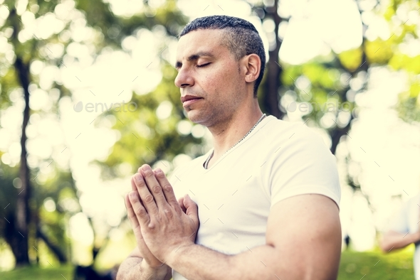 Person doing yoga at the park - Stock Photo - Images