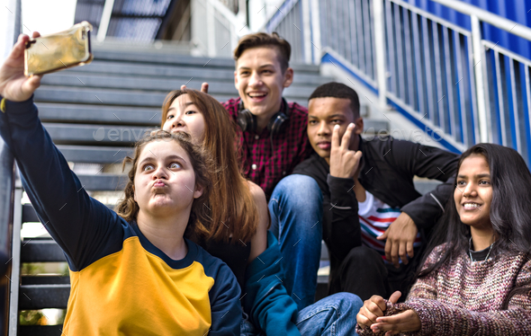 Group of school friends having fun and taking a selfie - Stock Photo - Images